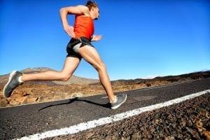 Man Running On The Asphalt Road