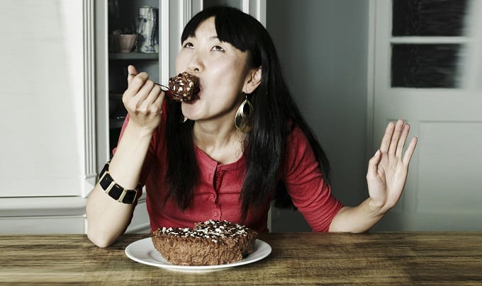 Woman Eating Cake By Herself