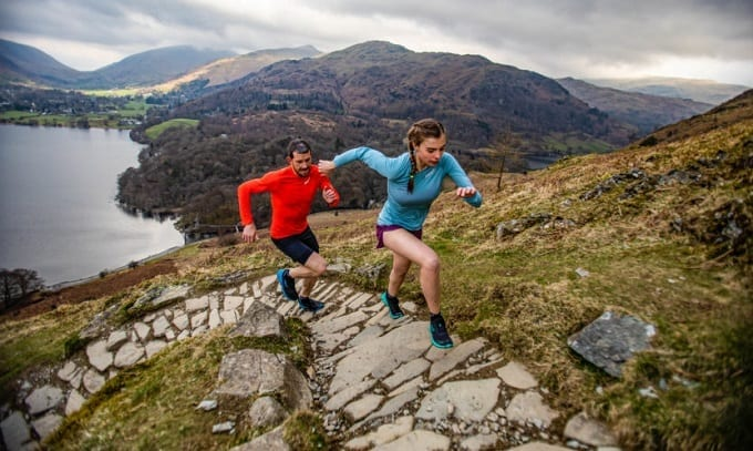 Young Couple Running Uphill