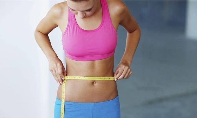 Woman Showing Flat Stomach