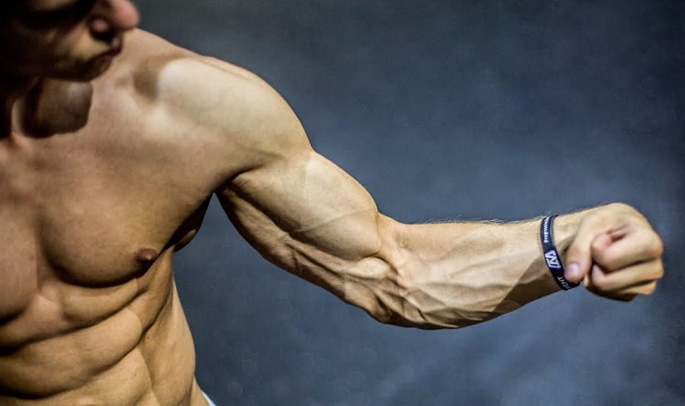 Ripped Man Showing Hand Muscles