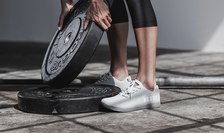 woman weightlifting with nobull shoes for crossfit
